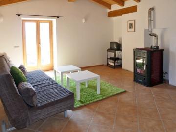 Wohnraum mit Zugang zum Balkon Casa Angelica